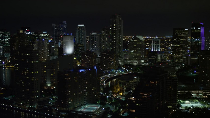 5K stock footage aerial video flyby skyscrapers on Brickell Key in Downtown Miami at night, Florida Aerial Stock Footage | AX0023_049E