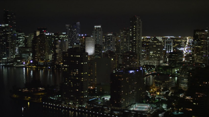 5K stock footage aerial video flyby Brickell Key and mainland skyscrapers in Downtown Miami at nighttime, Florida Aerial Stock Footage | AX0023_050
