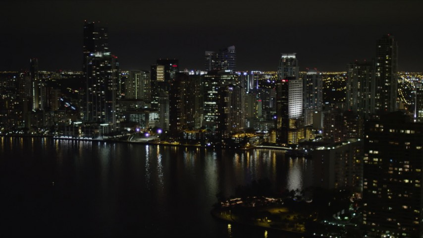 5K stock footage aerial video of waterfront skyscrapers at night in Downtown Miami, Florida Aerial Stock Footage | AX0023_051