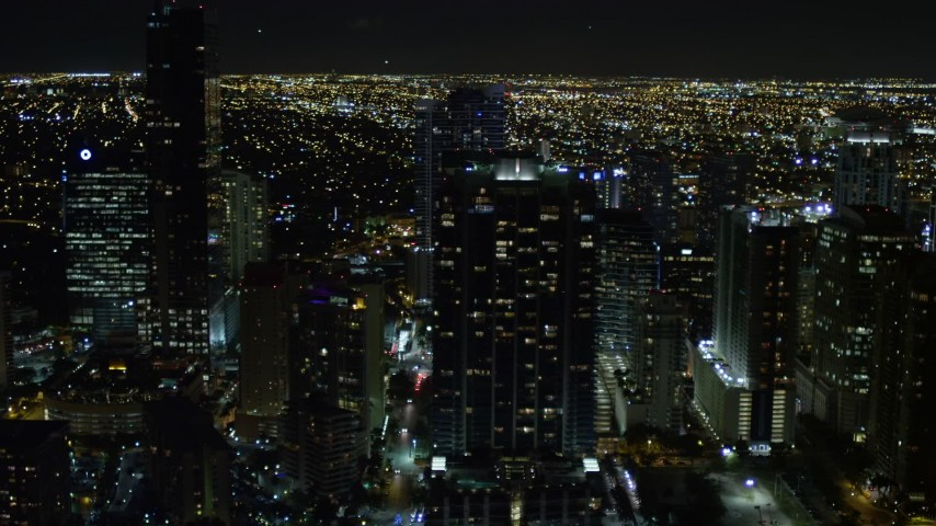 5K stock footage aerial video of Jade at Brickell Bay overlooking the water at night in Downtown Miami, Florida Aerial Stock Footage | AX0023_053