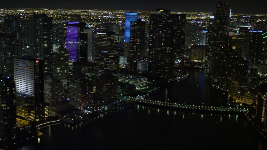 5K stock footage aerial video pan across Downtown Miami skyscrapers at night, Florida Aerial Stock Footage | AX0023_054