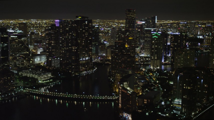 5K stock footage aerial video flyby Brickell Key high-rises at night in Downtown Miami, Florida Aerial Stock Footage | AX0023_055