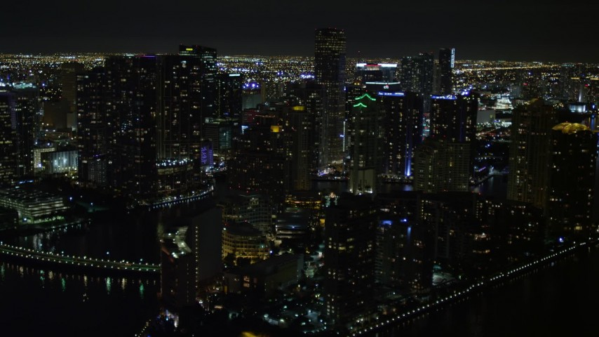 5K stock footage aerial video flyby Brickell Key high-rises at night in Downtown Miami, Florida Aerial Stock Footage | AX0023_055E