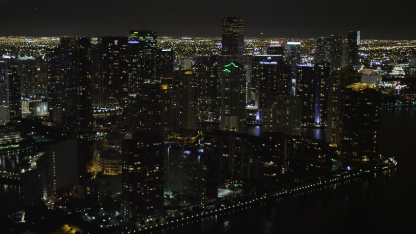 5K stock footage aerial video of bayside skyscrapers on Brickell Key at night in Downtown Miami, Florida Aerial Stock Footage | AX0023_056