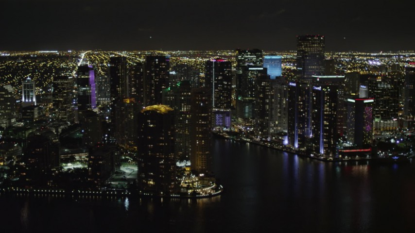 5K aerial stock footage video of Downtown Miami skyscrapers around the Miami River at nighttime in Florida Aerial Stock Footage   AX0023_058