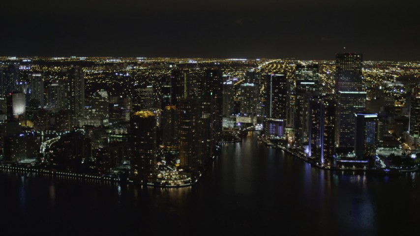 5K stock footage aerial video of Downtown Miami high-rises on Brickell Key and by Miami River at nighttime in Florida Aerial Stock Footage | AX0023_059