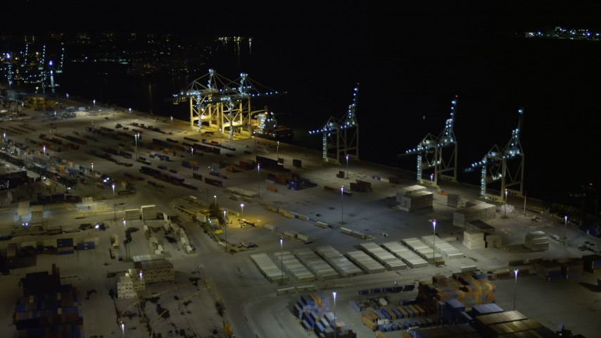 5K stock footage aerial video approach cargo cranes and ship at the Port of Miami at night, Florida Aerial Stock Footage | AX0023_060E