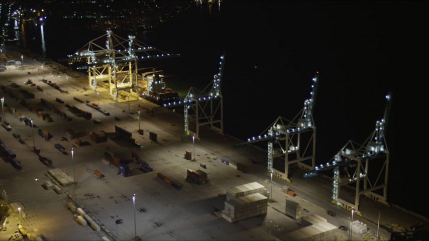 5K stock footage aerial video fly over cranes to approach a cargo ship at the Port of Miami at night, Florida Aerial Stock Footage | AX0023_061