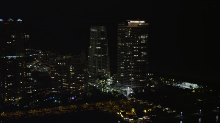 5K stock footage aerial video of waterfront skyscrapers on the shore of South Beach, Florida at night Aerial Stock Footage | AX0023_066