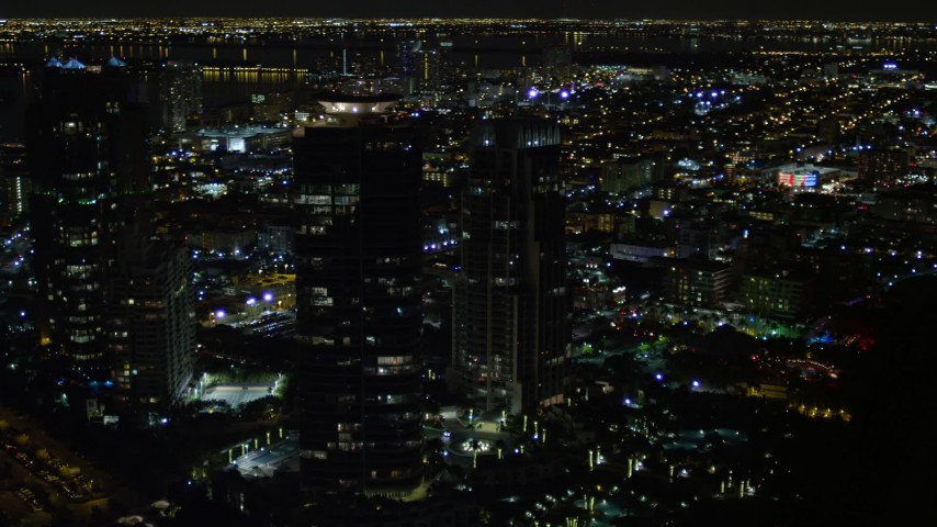 Trio of Modern Skyscrapers at Night in South Beach, Florida Aerial Stock Footage | AX0023_068