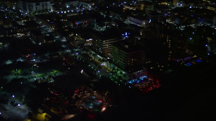 5K stock footage aerial video of beachfront park and hotel at night in South Beach, Florida Aerial Stock Footage | AX0023_069