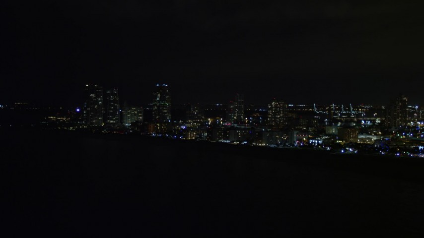5K stock footage aerial video of South Beach seen from the ocean at night in Florida Aerial Stock Footage | AX0023_074