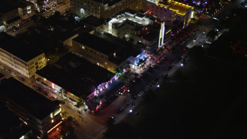 5K stock footage aerial video of bird's eye view of hotels and Ocean Drive at night in South Beach, Florida Aerial Stock Footage | AX0023_076