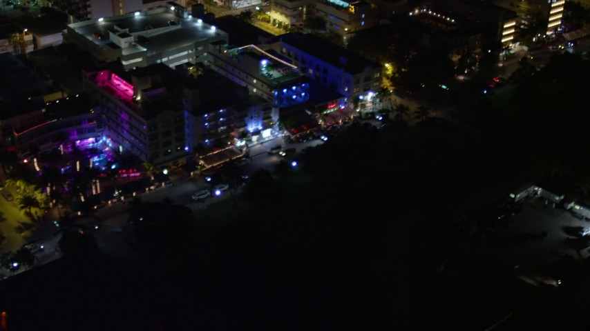 5K stock footage aerial video of passing by hotels and Ocean Drive at night in South Beach, Florida Aerial Stock Footage | AX0023_076E