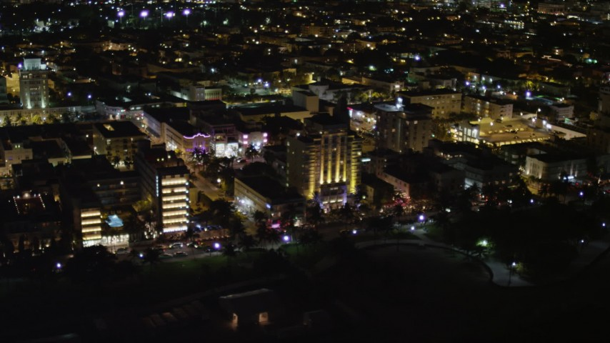 5K aerial video flyby hotels on Ocean Drive at night in South Beach, Florida Aerial Stock Footage | AX0023_077