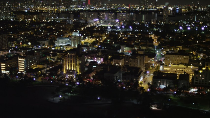 5K stock footage aerial video flyby brightly lit hotels at night in South Beach, Florida Aerial Stock Footage | AX0023_078