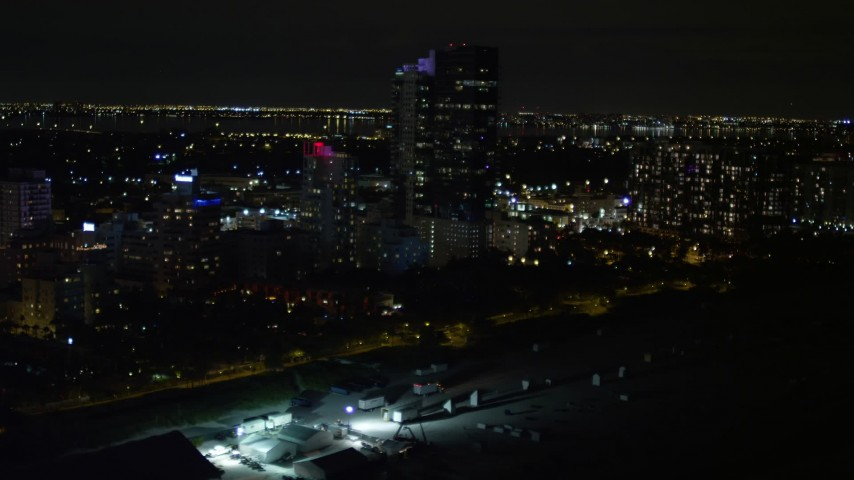 5K stock footage aerial video of beachfront hotel at night in Miami Beach, Florida Aerial Stock Footage | AX0023_079E
