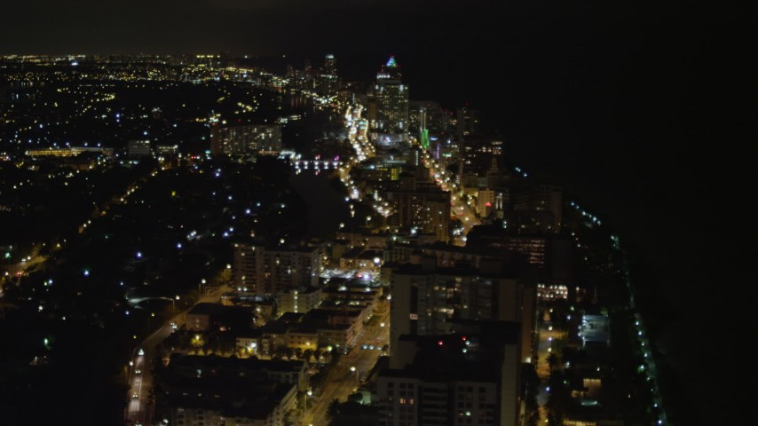 5K stock footage aerial video of busy streets through Miami Beach at nighttime, Florida Aerial Stock Footage | AX0023_081