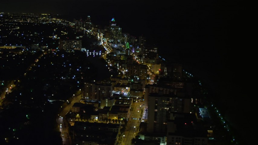 5K stock footage aerial video of busy streets through Miami Beach at nighttime, Florida Aerial Stock Footage | AX0023_081E