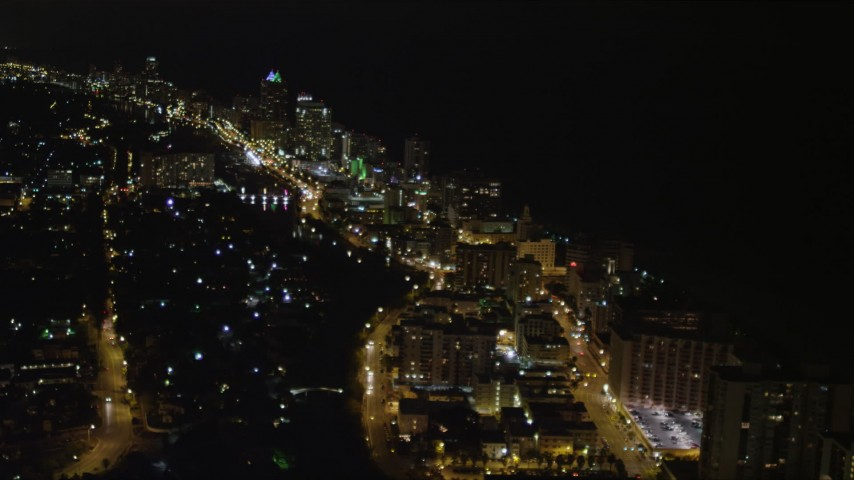 5K stock footage aerial video of traffic moving through streets at night in Miami Beach, Florida Aerial Stock Footage | AX0023_082