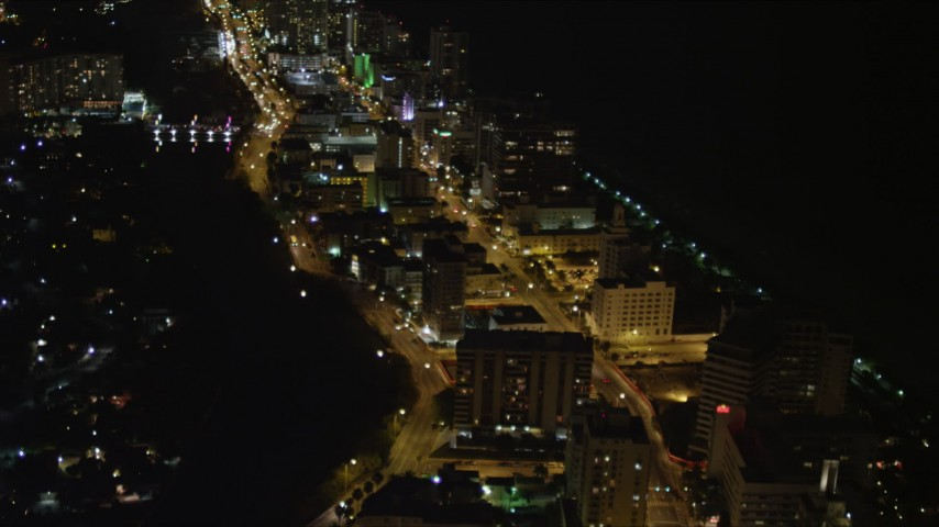 5K stock footage aerial video fly over busy streets through Miami Beach at night, Florida Aerial Stock Footage   AX0023_083