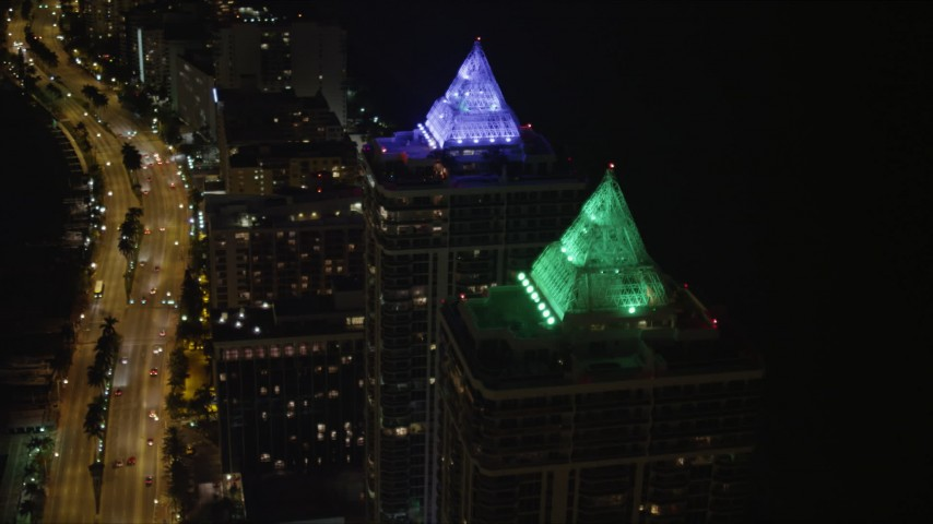5K stock footage aerial video approach Blue and Green Diamonds skyscrapers at night in Miami Beach, Florida Aerial Stock Footage | AX0023_087