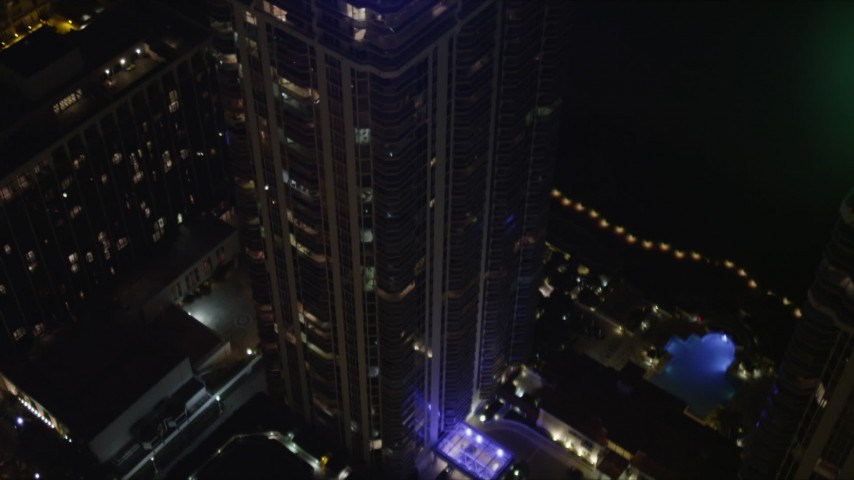 5K stock footage aerial video tilt to bird's eye view of Blue and Green Diamonds skyscrapers at night in Miami Beach, Florida Aerial Stock Footage | AX0023_088