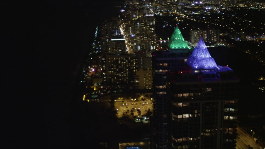 5K stock footage aerial video orbit the Blue and Green Diamonds skyscrapers with lighting at night in Miami Beach, Florida Aerial Stock Footage | AX0023_089