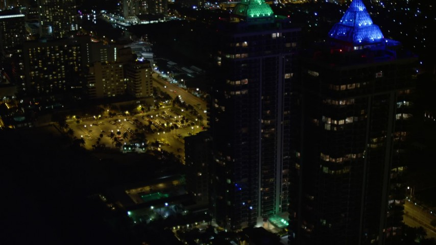 5K stock footage aerial video orbit the Blue and Green Diamonds skyscrapers with lighting at night in Miami Beach, Florida Aerial Stock Footage | AX0023_089E