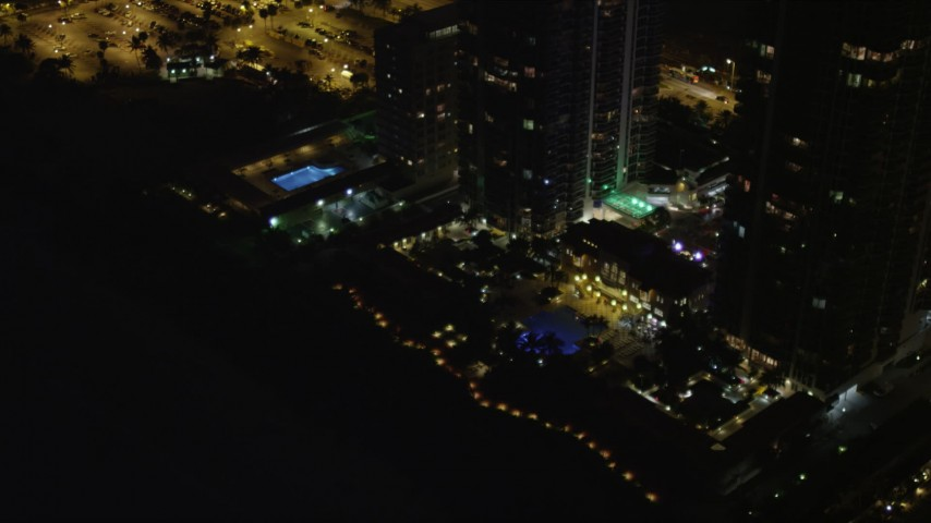 5K stock footage aerial video tilt from rooftop to base of Blue and Green Diamonds skyscrapers at night in Miami Beach, Florida Aerial Stock Footage | AX0023_090