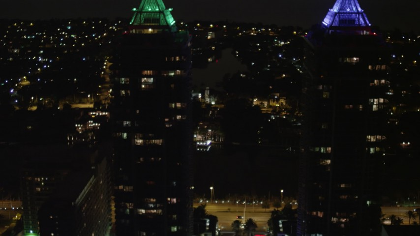 5K aerial video tilt from base to rooftops of Blue and Green Diamonds skyscrapers at night in Miami Beach, Florida Aerial Stock Footage | AX0023_091