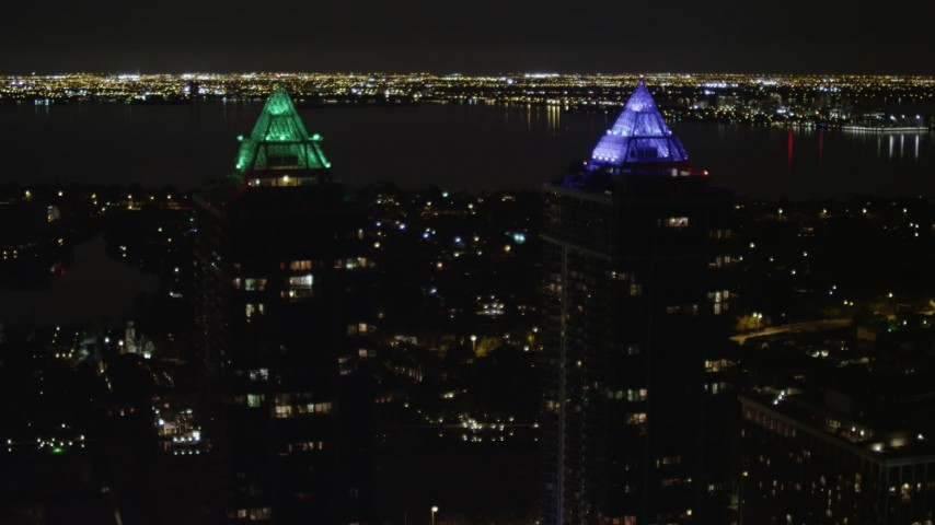5K stock footage aerial video of Blue and Green Diamonds skyscrapers at night in Miami Beach, Florida Aerial Stock Footage | AX0023_092