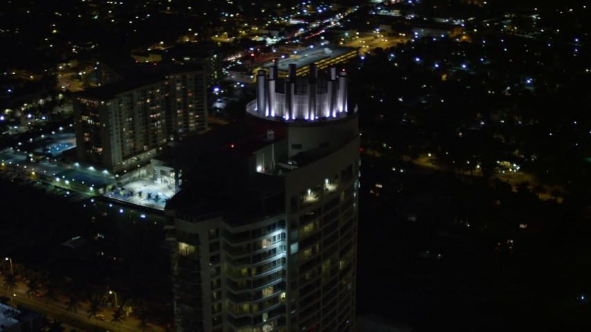 5K stock footage aerial video tilt to the Fontainebleau Miami Beach Resort rooftop at night, Florida Aerial Stock Footage | AX0023_093E