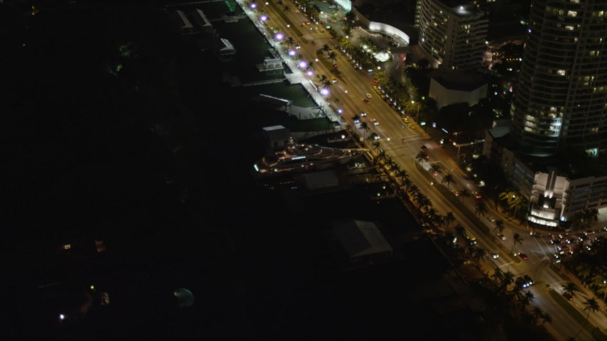 5K stock footage aerial video of yacht docked by Collins Avenue at night in  Miami Beach, Florida Aerial Stock Footage | AX0023_095