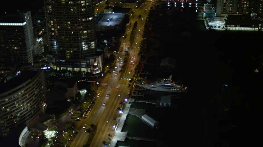 5K stock footage aerial video of yacht docked by Collins Avenue at night in  Miami Beach, Florida Aerial Stock Footage | AX0023_095E