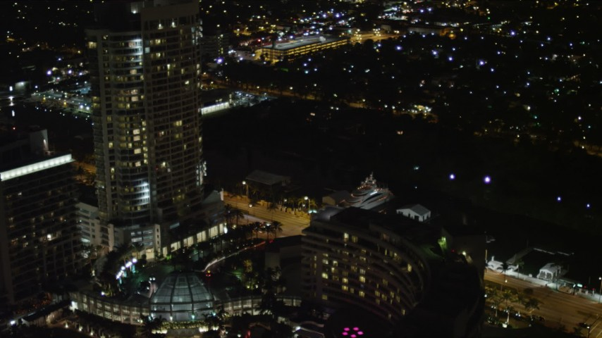 5K stock footage aerial video orbit Fontainebleau Miami Beach Resort Hotel and yacht at night, Florida Aerial Stock Footage | AX0023_098