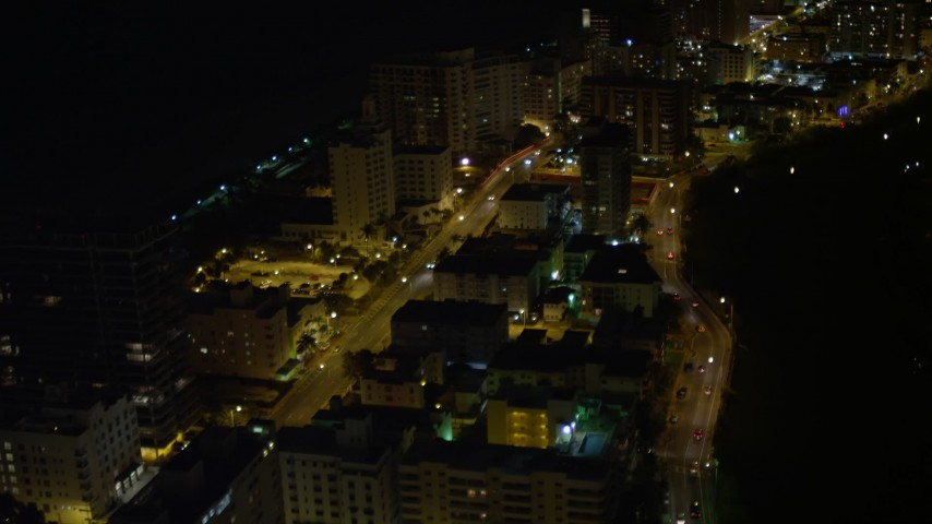 5K stock footage aerial video fly over Indian Creek Drive through Miami Beach at night, Florida Aerial Stock Footage | AX0023_102E