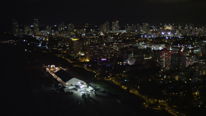 5K stock footage aerial video flying by hotels by the beach at night in Miami Beach, Florida Aerial Stock Footage | AX0023_107