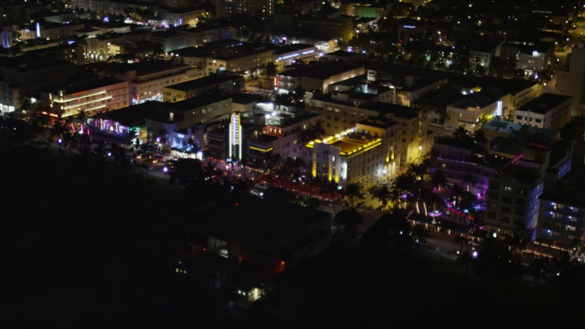 5K stock footage aerial video of row of hotels on Ocean Drive at night in South Beach, Florida Aerial Stock Footage | AX0023_110