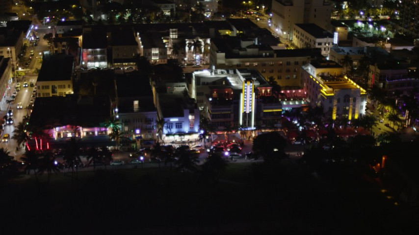 5K aerial video flyby hotels on Ocean Drive at nighttime in South Beach, Florida Aerial Stock Footage | AX0023_111