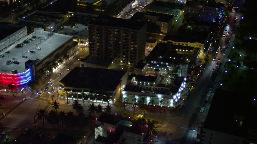 5K stock footage aerial video of orbit small hotel and city streets at night in South Beach, Florida Aerial Stock Footage | AX0023_113