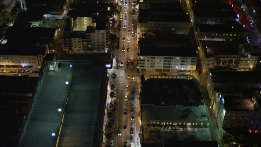 5K stock footage aerial video fly over cars on Collins Avenue at night through South Beach, Florida Aerial Stock Footage | AX0023_114