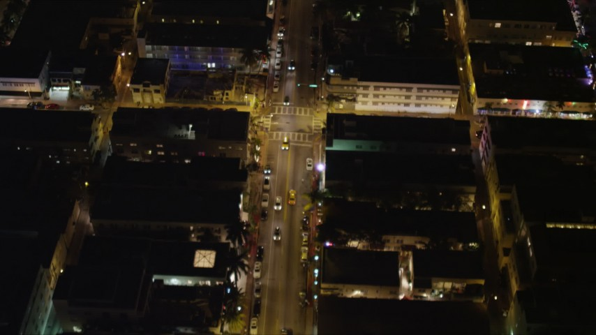 5K stock footage aerial video fly over traffic on Collins Avenue at night through South Beach, Florida Aerial Stock Footage | AX0023_115