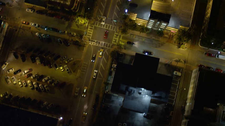 5K stock footage aerial video bird's eye view of a street through South Beach at night, Florida Aerial Stock Footage | AX0023_117