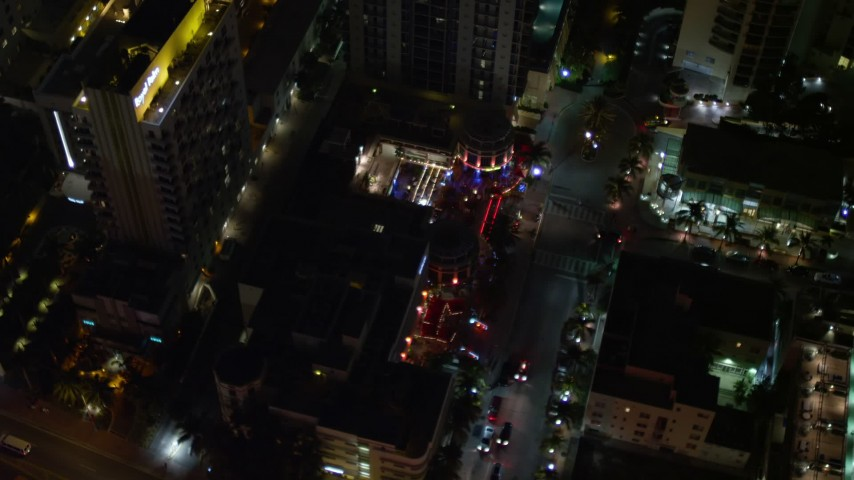 5K stock footage aerial video of Bancroft Hotel at night in South Beach, Florida Aerial Stock Footage   AX0023_118E