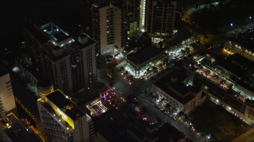 5K stock footage aerial video orbit Bancroft Hotel and condo complex at night in South Beach, Florida Aerial Stock Footage | AX0023_119