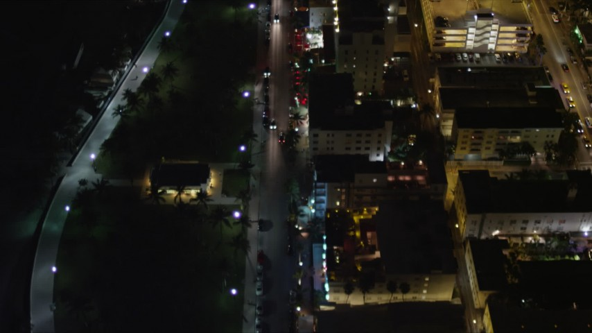 5K stock footage aerial video of a bird's eye view of Ocean Drive through South Beach at night, Florida Aerial Stock Footage | AX0023_120