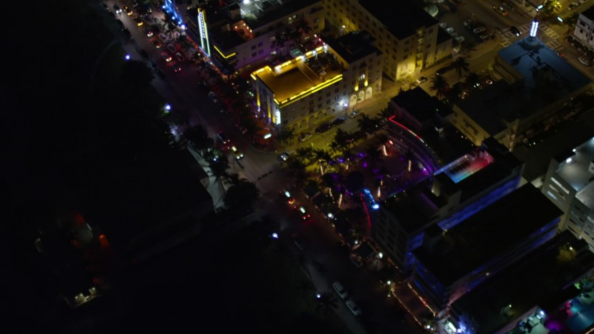 5K stock footage aerial video of a bird's eye view of Ocean Drive's hotels in South Beach at night, Florida Aerial Stock Footage   AX0023_120E