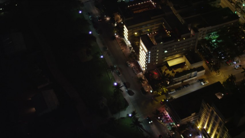 5K aerial video bird's eye view of hotels and lights on Ocean Drive at night in South Beach, Florida Aerial Stock Footage | AX0023_121