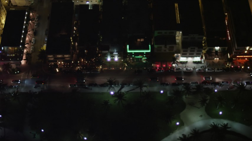 Ocean Drive Hotels at Night in South Beach, Florida Aerial Stock Footage | AX0023_123